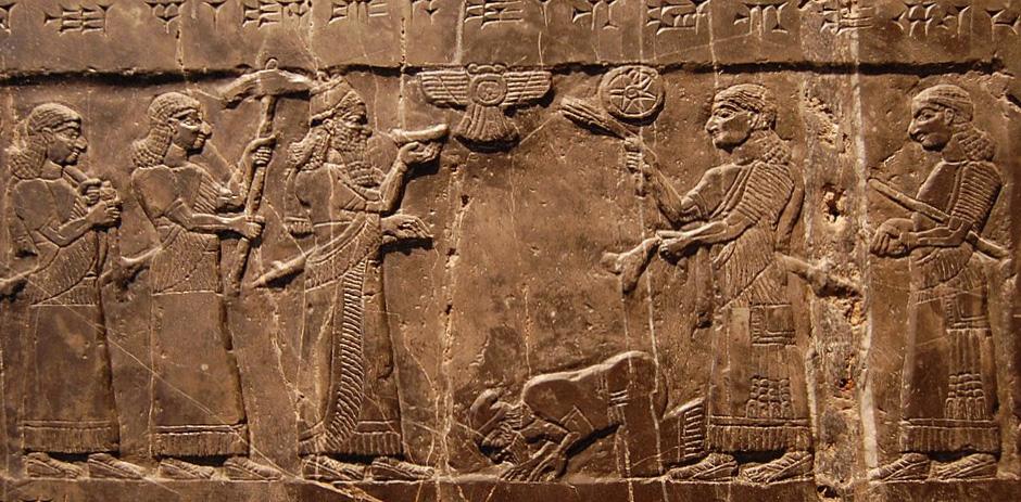 Asyryjski król Salmanasar III odbiera hołd od wodza podbitego ludu.