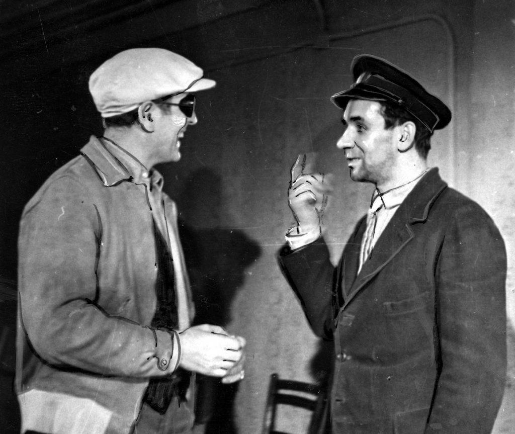 Scena z filmu Heimkehr. Widoczni Gustav Ucicky (od lewej ) i Józef Kondrat (domena publiczna).