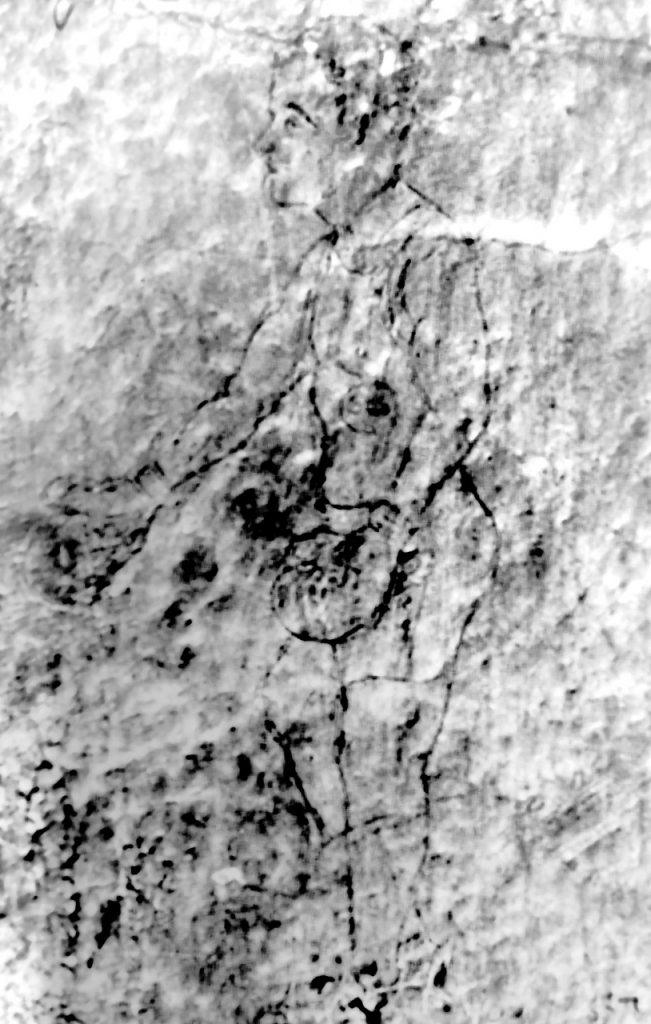 Rysunek boksera wydrapany przez nieznanego autora na ścianie celi nr 18 bloku 11 (tzw. bloku śmierci) w obozie w Auschwitz. Tadeusz Pietrzykowski rozpoznał na rysunku siebie. Zdjęcie i podpis z książki Gladiatorzy śmierci (materiały prasowe).